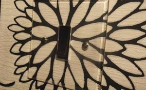 How to Install a Crystal Clear Light Switch Over Wallpaper